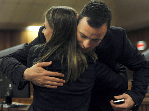 Oscar Pistorius is greeted by his sister Aimee Pistorius