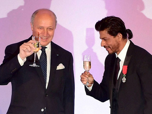 Bollywood superstar Shah Rukh Khan raises his glass