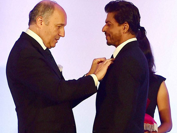 Bollywood superstar Shah Rukh Khan being conferred with Chevalier de la Legion