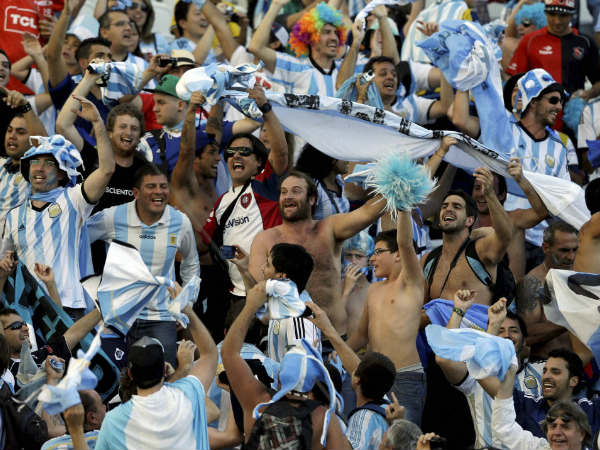 Argentine fans celebrate their Round of 16 win against Switzerland on July 1