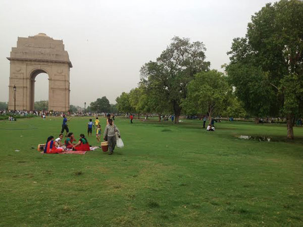 People sitting next to India Gate, New Delhi