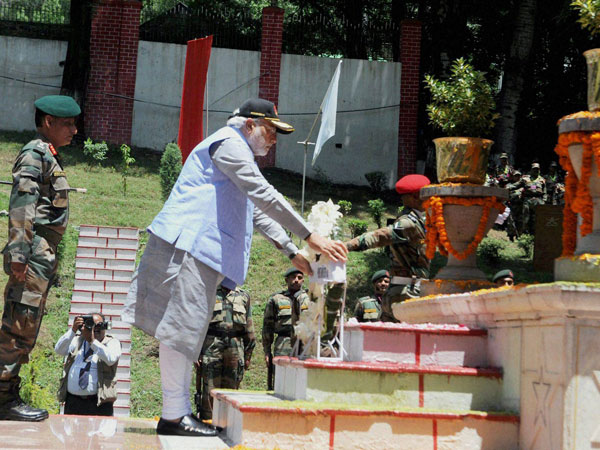 Prime Minister Narendra Modi laying a wreath at martyrs memorial