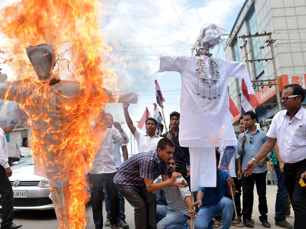Asom Gana Parishad (AGP) activists burn effigies of Assam Chief Minister Tarun Gogoi