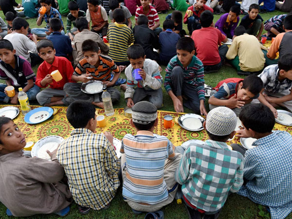 Inmates of an orphanage breaking their fast on 5th day