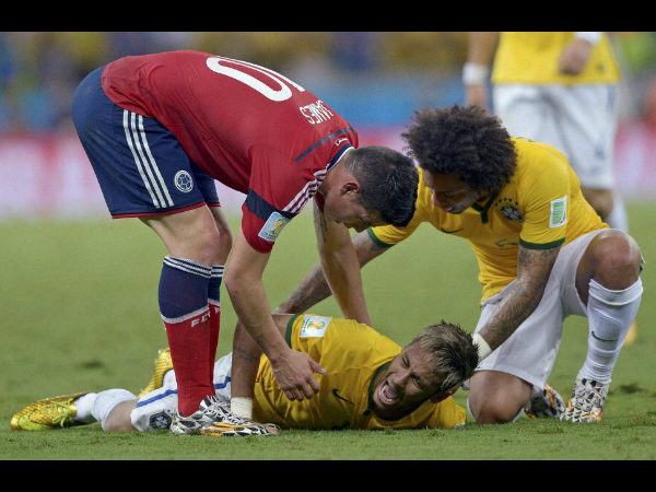 Brazil's Neymar screams out after being fouled during their World Cup quarterfinal match against Colombia at the Arena Castelao in Fortaleza, Brazil, Friday, July 4