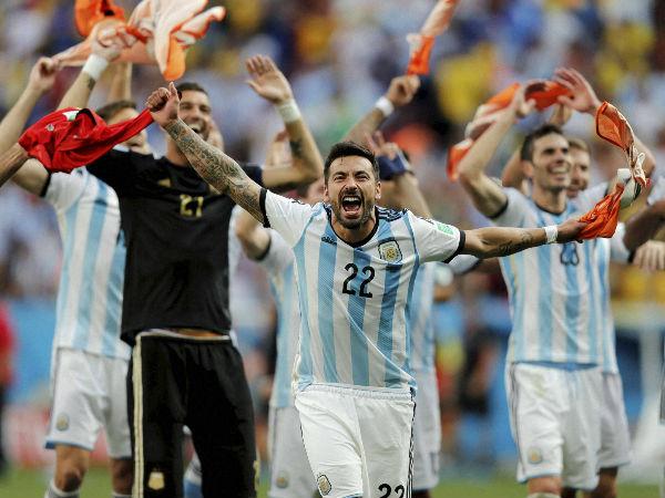 Argentina's Ezequiel Lavezzi and teammates celebrate their quarter-final win over Belgium yesterday