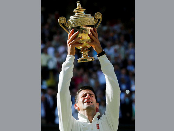 Novak Djokovic of Serbia holds up the trophy