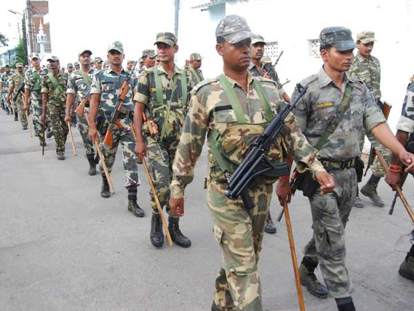 Security personnel conduct flag march on the streets