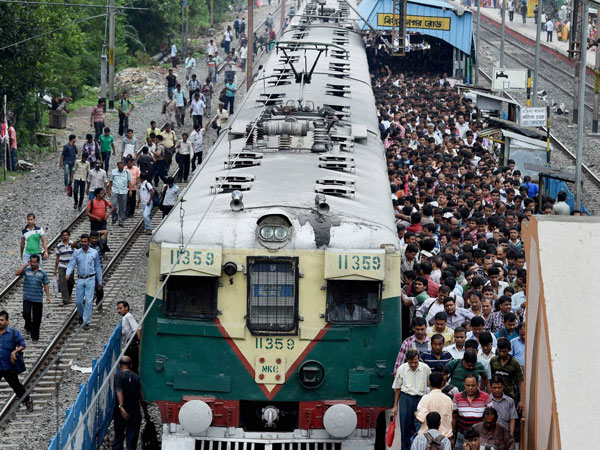 Hundreds of passengers arrive by a local train