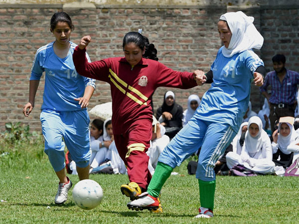School girls in action during a football tournament