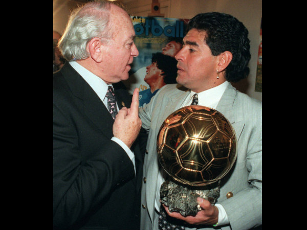 In this January 3, 1995 file photo, former Argentina soccer star Alfredo di Stefano, left, congratulates fellow countryman Diego Maradona after he received the Golden Ball award for his lifetime achievement, in Paris.