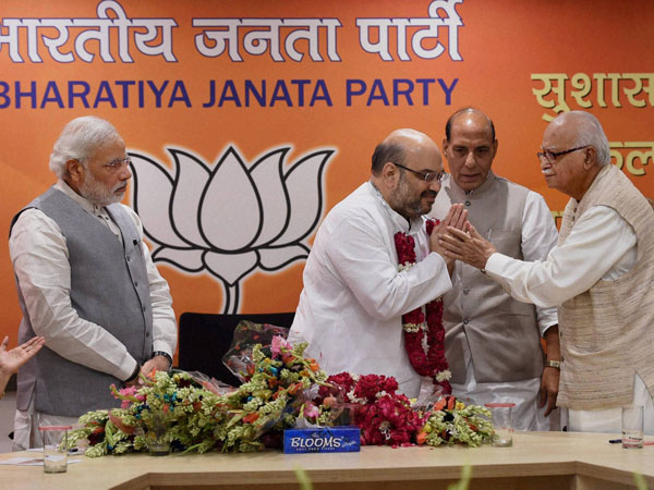 BJP President Amit Shah is greeted by senior leader LK Advani
