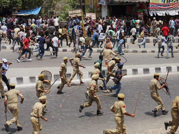 Police in action against the students who were protesting