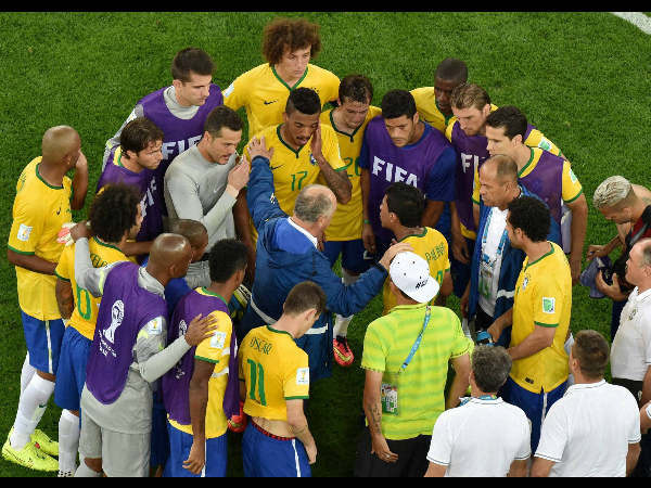 Brazil's coach Luiz Felipe Scolari talks to his players after the World Cup semifinal match against Germany.