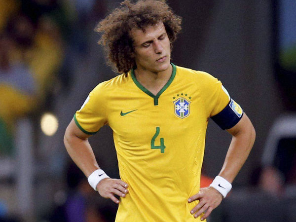 Brazil's captain David Luiz reacts after Germany scored their fifth goal