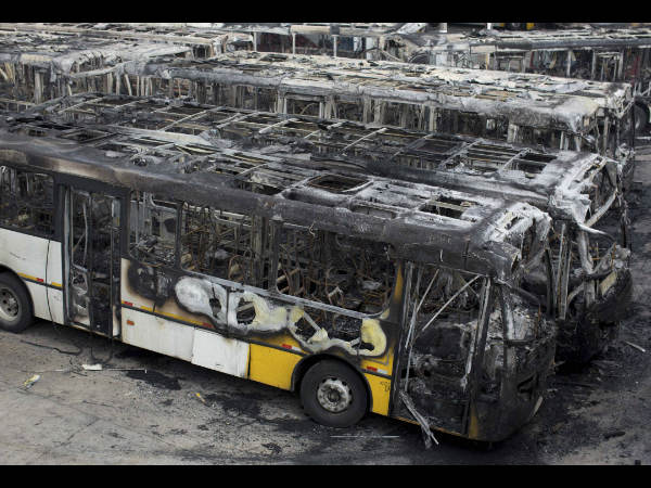Passenger buses that were torched a day earlier are parked at a depot in Sao Paulo, Brazil, Wednesday, July 9, 2014. Brazilians woke up Wednesday to dreadful headlines describing the shame and humiliation of their soccer team's historic defeat of 7-1 to Germany in the World Cup's semifinal. There were also reports of violence breaking out right after the game with at least 20 passenger buses being torched in the country's biggest city.