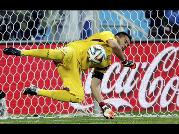 Argentina's goalkeeper Sergio Romero saves a shot from the penalty spot by Netherlands' Ron Vlaar