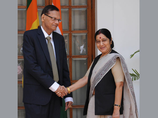 External Affairs Minister Sushma Swaraj shakes hands with her Sri Lankan counterpart