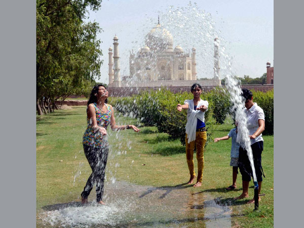 Girls trying to cool themselves off near Taj Mahal in Agra