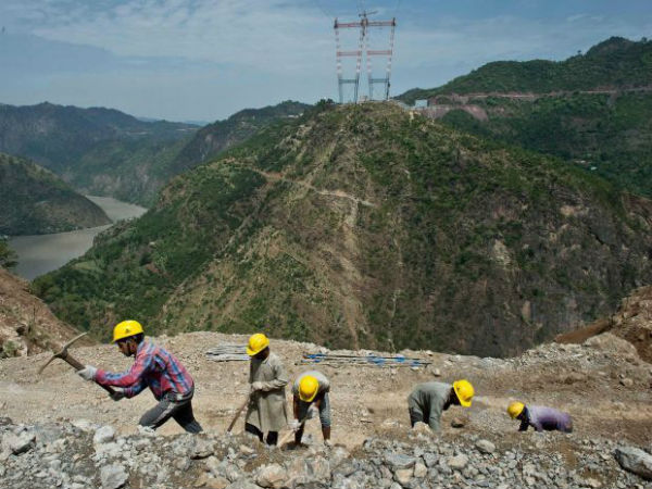Indian labourers at site in the Himalayas working on the world's highest railway bridge. (AFP Photo)