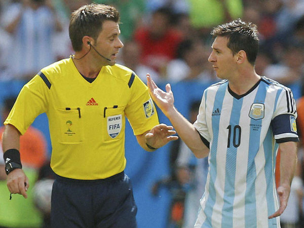 Messi, right, speaks to referee Nicola Rizzoli of Italy during the World Cup quarterfinal match between Argentina and Belgium in Brasilia on July 5