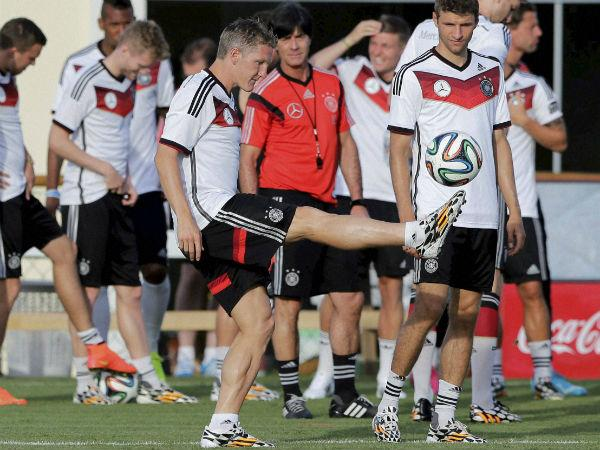 Joachim Loew (in red) keeps a firm eye on German players