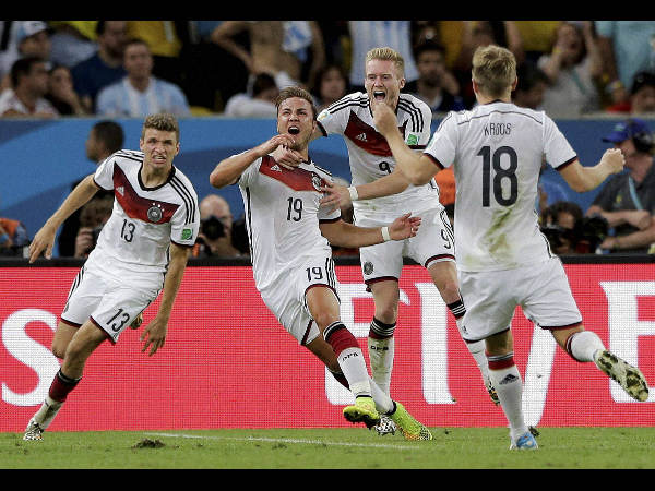 Germany's Mario Goetze (19) celebrates after scoring the opening goal in the 113th minute. This was the winning goal of the final