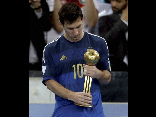 Lionel Messi with his Golden Ball award