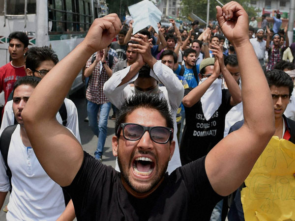 Students shout slogans during a protest