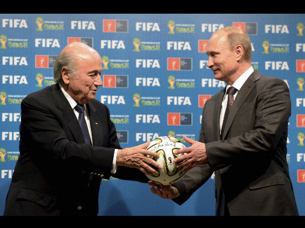 In this photo taken on Sunday, July 13, 2014, FIFA President Sepp Blatter, left, and Russian President Vladimir Putin are seen during the official ceremony of handover to Russia as the 2018 World Cup hosts, after the World Cup final between Germany and Argentina at the Maracana Stadium in Rio de Janeiro, Brazil.