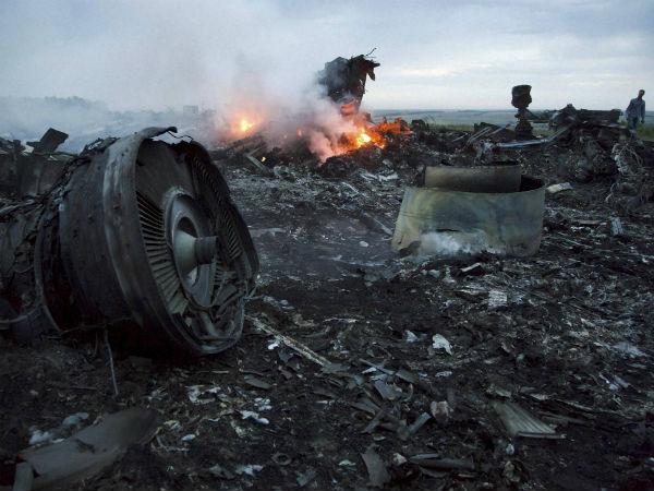 Debris at the crash site of a passenger plane near the village of Hrabove, Ukraine on Thursday.(PTI photo)