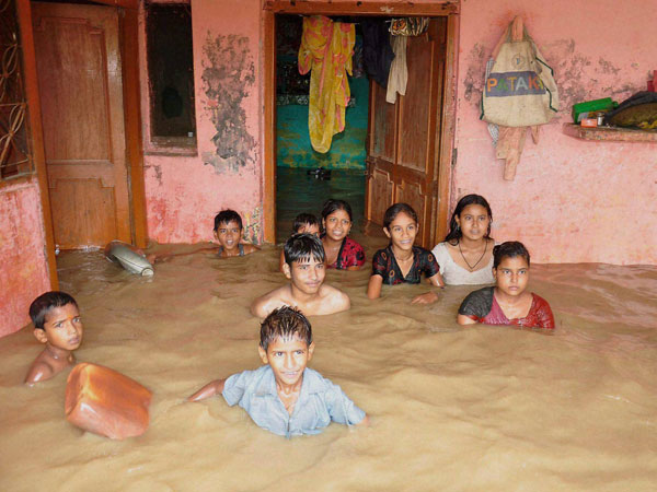 Children in a locality flooded by Ramganga River