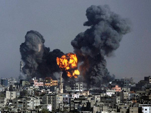 Smoke and fire from the explosion of an Israeli strike rise over Gaza
