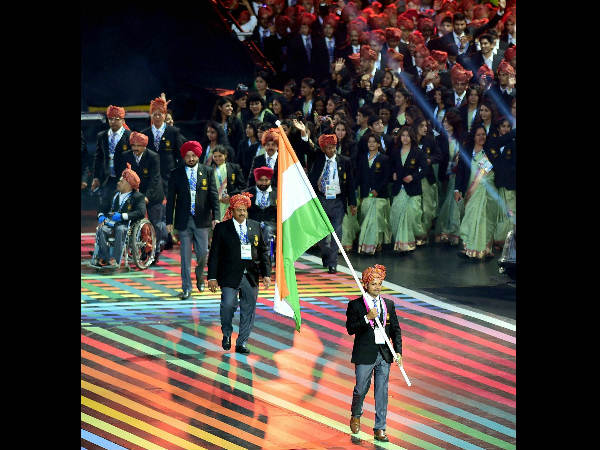 Ace shooter Vijay Kumar holds the Tricolour as he leads the Indian contingent at Celtic Park during the opening ceremony of Commonwealth Games in Glasgow, Scotland on Wednesday.