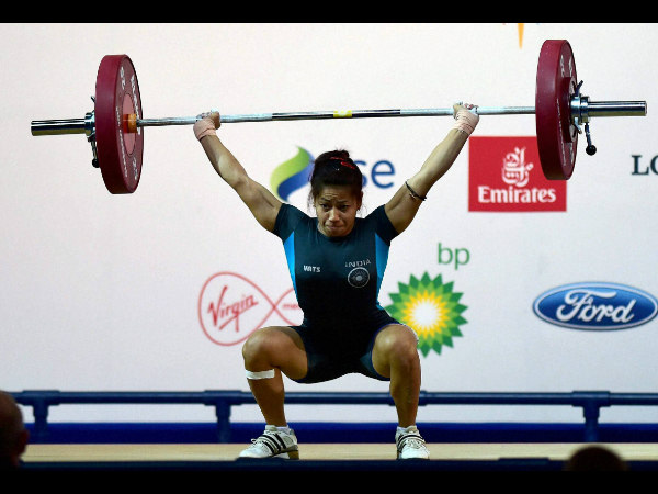 India's Sanjita Khumukcham completes a lift during the 48-kg women's weightlifting event at the Commonwealth Games in Glasgow, Scotland on Thursday.