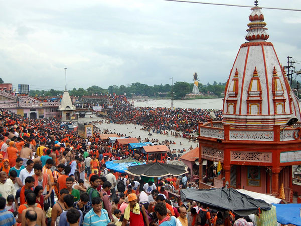 Kanwariyas taking holy dip and collecting holy Ganga