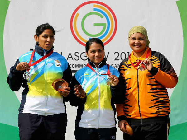 India's gold medalist Apurvi Chandela, centre, poses for photographers with teammate and silver medalist Ayonika Paul, left, and bronze medalist Malaysia's Nur Suryani Mohamed Taibi, following the 10m Rifle Women Final
