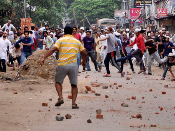 Stone pelters in action during the clashes. (PTI photo)