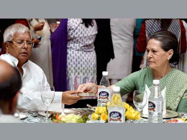 Congress President Sonia Gandhi offer dates to RJD chief Lalu Yadav