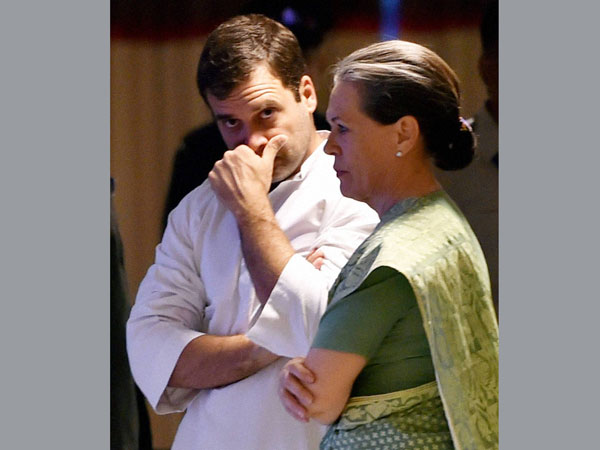 Congress President Sonia Gandhi with her son at an Iftar party