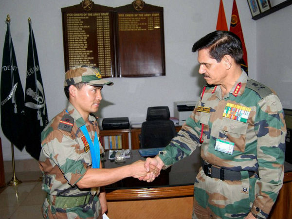 File photo of July 11, 2014: Vice Chief of Army Staff Lt Gen Dalbir Singh felicitates Nb Sub Jitu Rai in New Delhi on Friday on securing World No 1 ranking in pistol shooting.