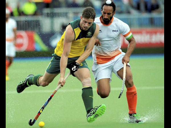 A file photo of India's Sardar Singh (right) in action against an Australian player
