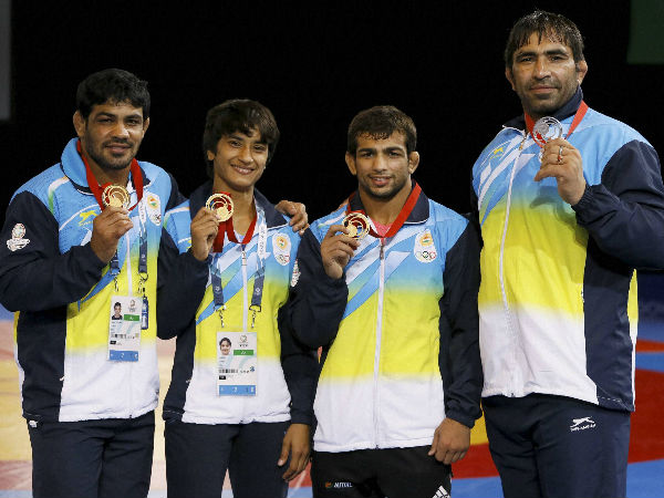 From left: India's wrestling medallists Sushil Kumar (gold), Vinesh Phogat (gold), Amit Kumar (gold) and Rajeev Tomar (silver) pose with their medals at the Scottish Exhibition Conference Centre during the Commonwealth Games 2014 in Glasgow on Tuesday (July 29).