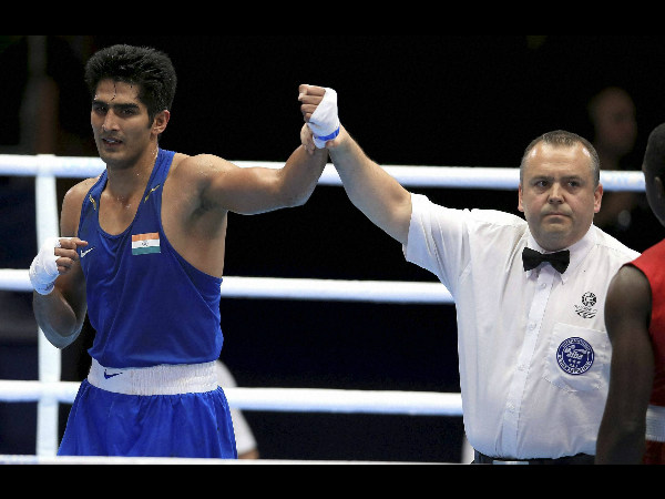 India's Vijender Singh is declared winner against Trinidad and Tobago's Aaron Prince after their Men's middle weight quarter-final