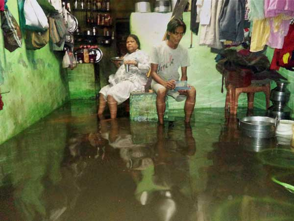 Water flooded at slum areas in Surat