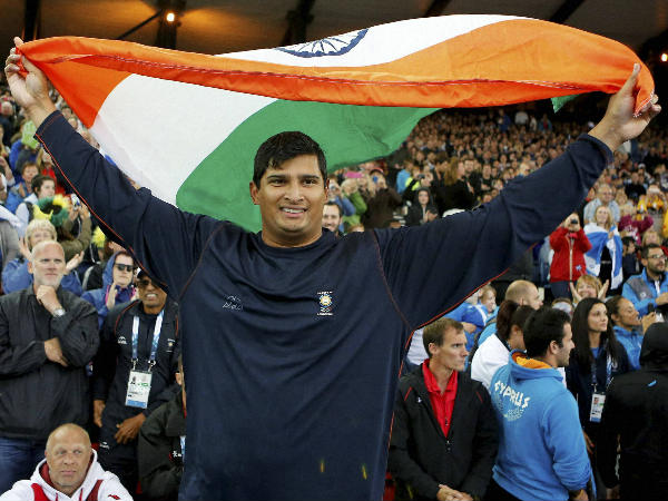 Vikas Gowda celebrates after winning the men's discus throw gold in Glasgow
