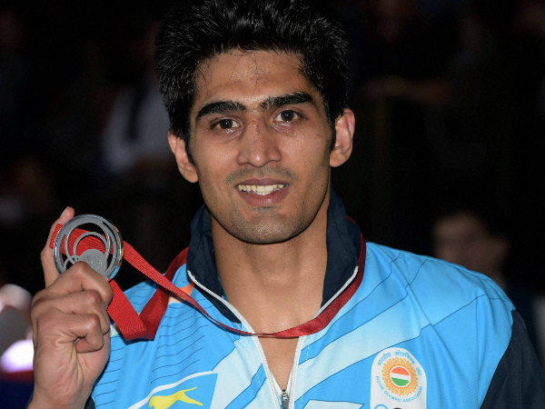 Boxer Vijender Singh with his silver medal