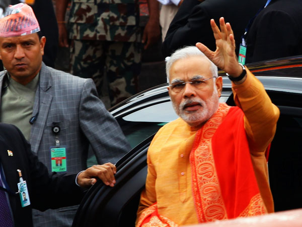 Minister Narendra Modi  waves to people