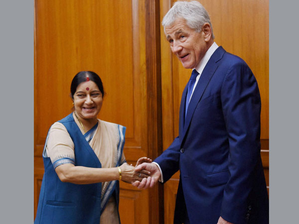 Sushma Swaraj shakes hand with US Secretary of Defence Chuck Hagel