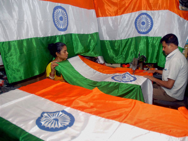 A tailor stitching the Indian National flag